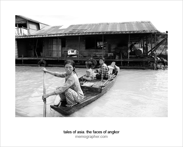 Three girls in a boat in Floating village on Tonle Sap Lake