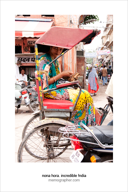 Woman taking Rickshaw. Jaipur, Rajasthan, India