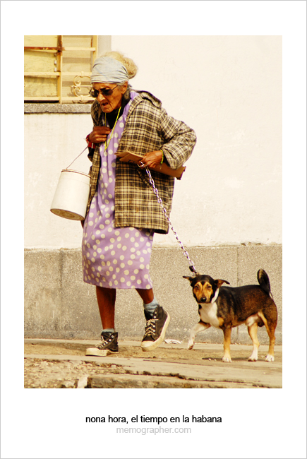 Old Woman walking a Dog. Havana, Cuba