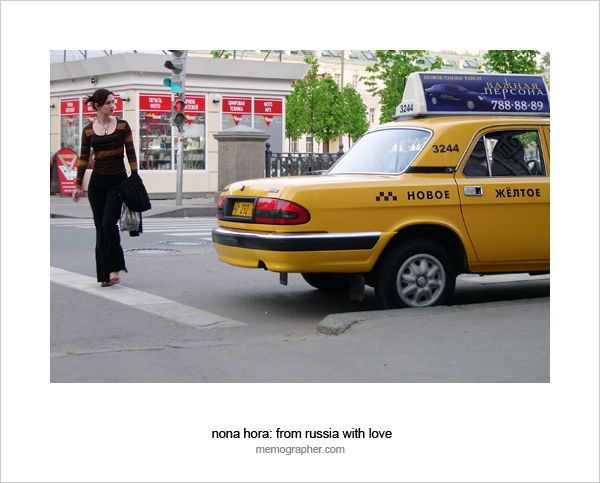 Pretty Girl and Yellow Taxi on Moscow Streets. Moscow, Russia