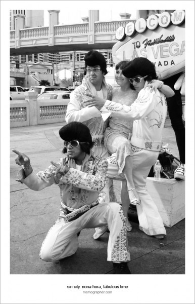 A Girl taking picture with Elvis Presley(s). Las Vegas, Nevada