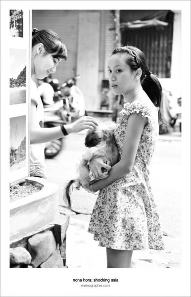Two Vietnamese Girls and a Dog. Hanoi, Vietnam