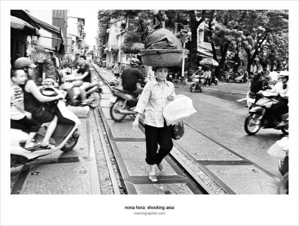Woman crossing the traffic. Hanoi, Vietnam