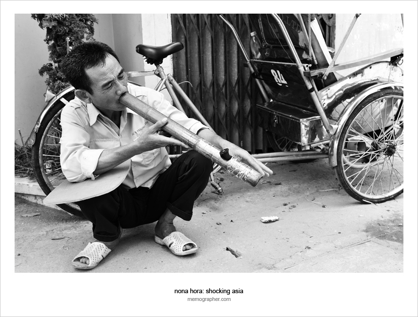 Man smoking Traditional Vietnamese Pipe. Hanoi, Vietnam