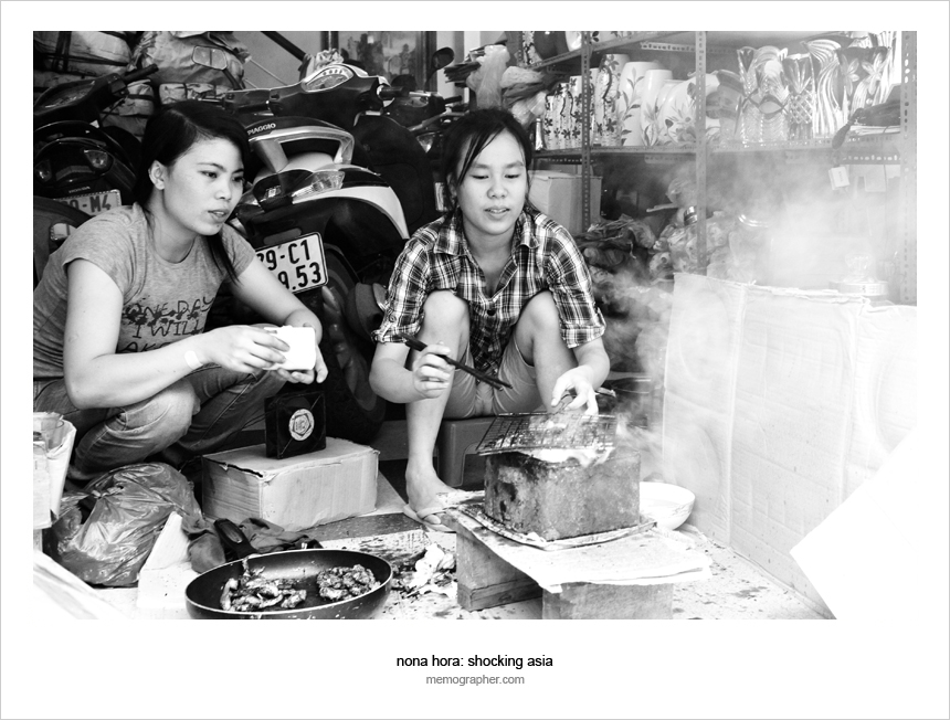 Two Vietnamese Girls cook inside of the store. Hanoi, Vietnam