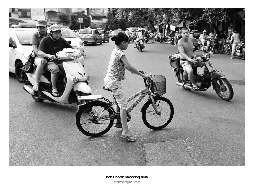 A Little Girl on bicycle in Hanoi Traffic