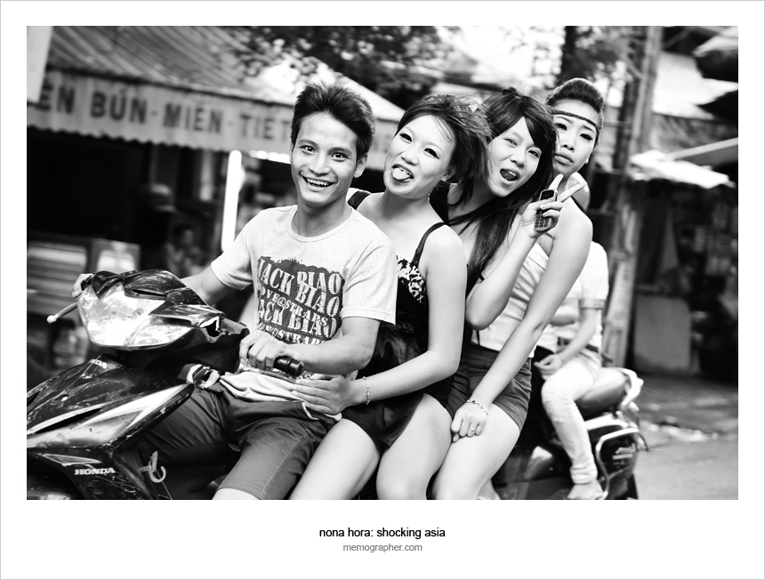 A Boy with Three Girls on Scooter. Hanoi, Vietnam