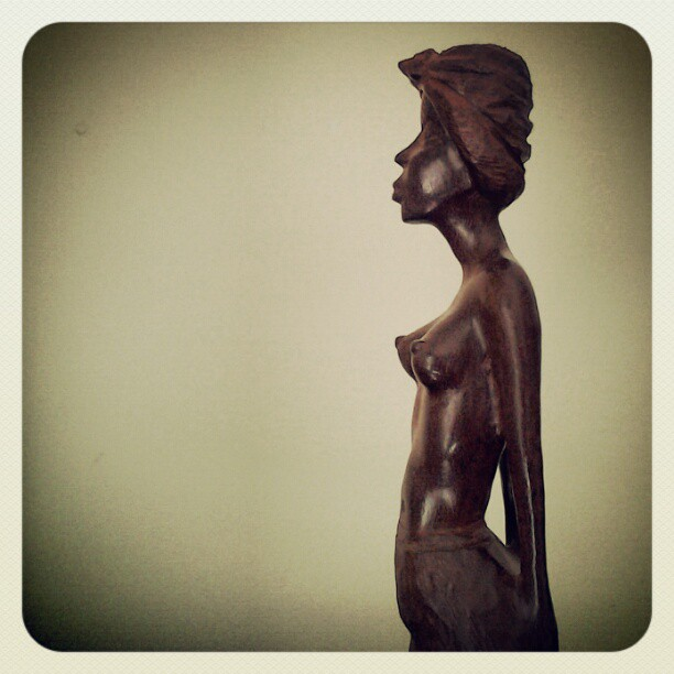 On My Shelves. A Bring-back from LaHabana, Cuba. A Wooden Figurine of a Topless Cuban Girl