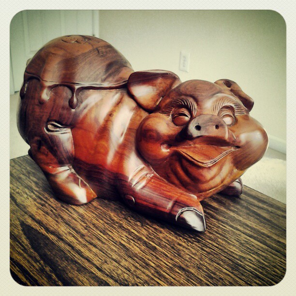 On My Shelves. A Bring-Back from Vietnam. A Wooden Figurine of Alex The Pig.