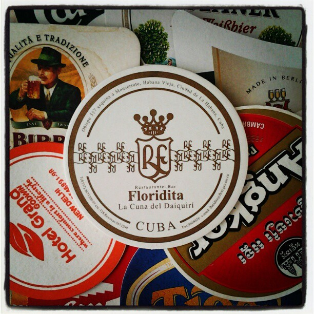 On My Shelves. Bring-Back Coasters from Cuba, India, Cambodia and other places