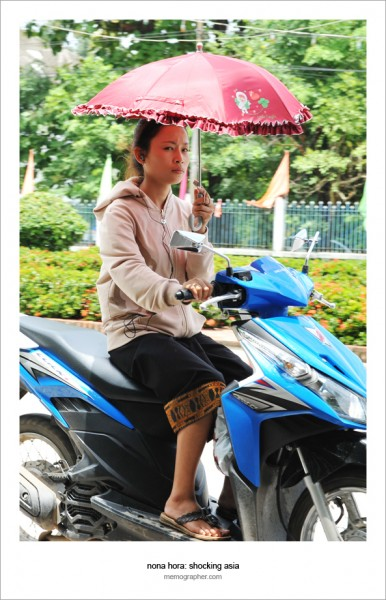 Lao Umbrella Girl on Scooter. Luang Prabang, Laos