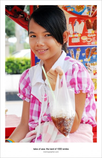 A Cute Thai Hawker Girl selling Coca-Cola in Plastic Bags