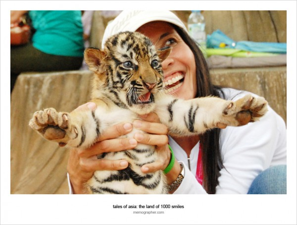 Thai Girl and Tiger Cub. Tiger Temple, Thailand