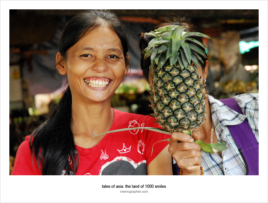 Two Thai Girls selling fruits in Thai village