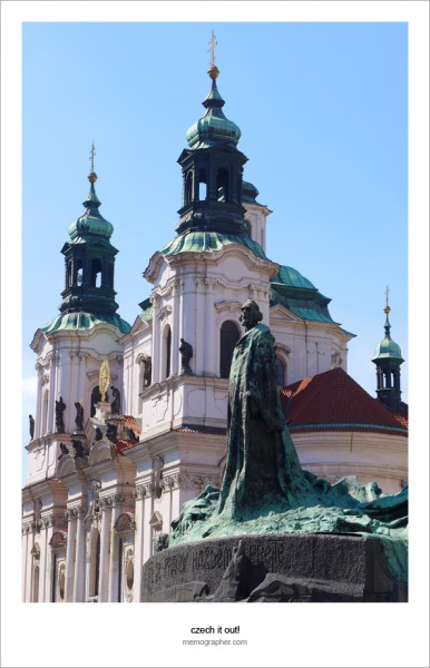 Jan Hus Statue and St. Nicholas Church. Prague, Czech Republic