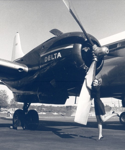 With a final hug from Stewardess Diane Strickland, the last of Delta's Convair 440 propeller planes retired from service on April 25, 1970