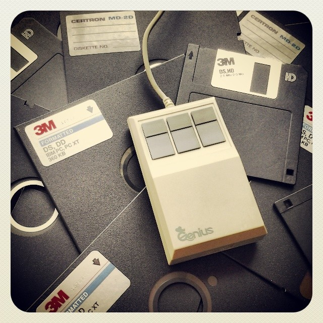 On My Shelves. Computer Diskettes, Floppy Disks and Three-Button Mouse from 1980s