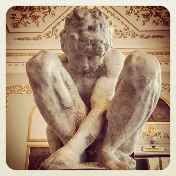 The Crouching Boy sculpture by Michelangelo